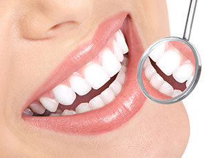 Woman smiling with dental mirror